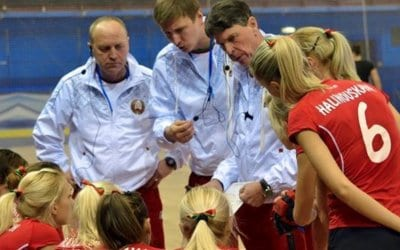 Herman Kruis and his staff coach Belarus woman's hockey team with AXIWI communication systems